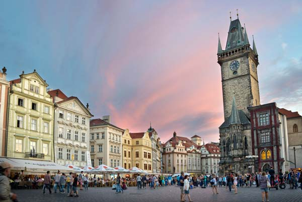 Tourists on the old town square of Prague at sunset, Czech republic