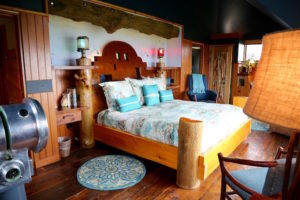 The top floor modern-rustic Captain's Quarters room, the largest in the main house, has spectacular oceanfront views and luxurious amenities.