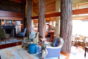 Large redwood posts that hold up the structure are bolted to the floor and rise up through the ceiling